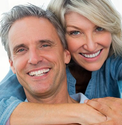 mid-age couple with best teeth