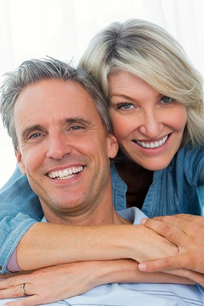 mid-age couple with best smile and white teeth