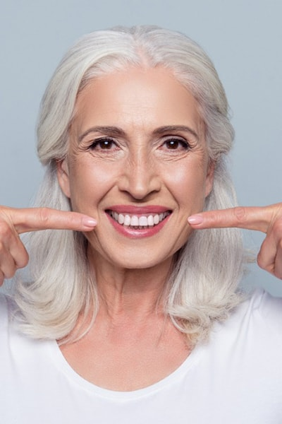 Russian mid age woman with dental implants
